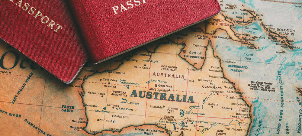 2 passports placed ontop a map showing Australia