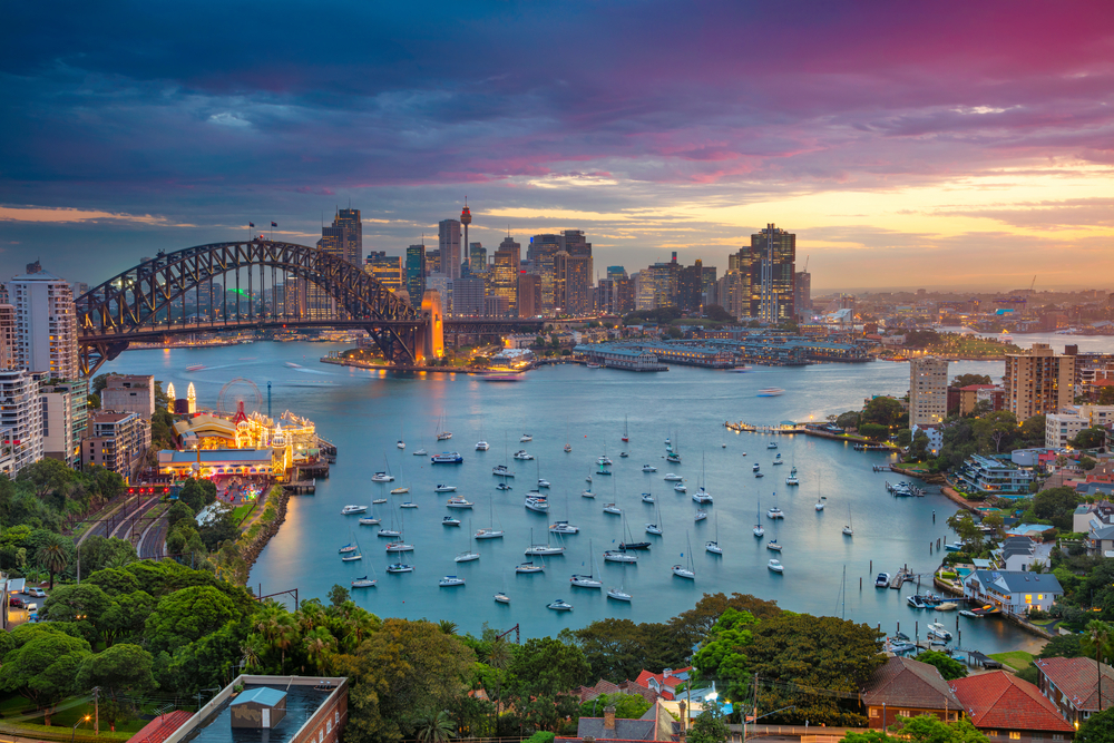 Sydney harbour at sunset. Featuring the Sydney harbour bridge and the skyline of the CBD